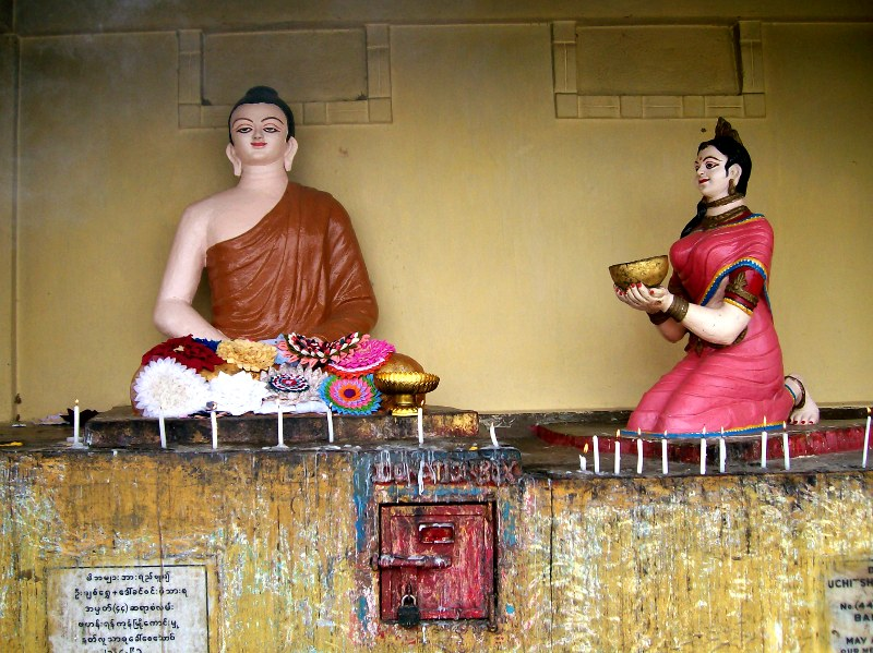 Sujata serving rice milk to the Buddha
